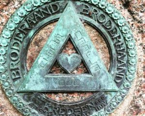 trekant med kodetekst